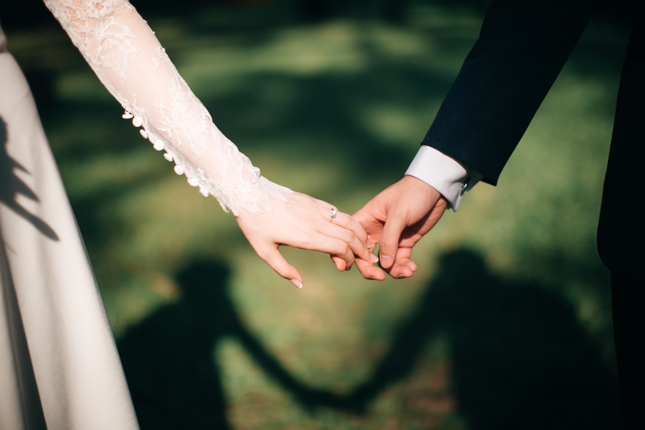 man and woman holding hands focus photo